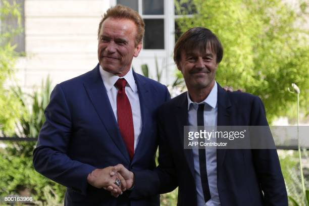 French Minister of Ecological and Inclusive Transition Nicolas Hulot shakes hands with former California governor Arnold Schwarzenegger founder of...