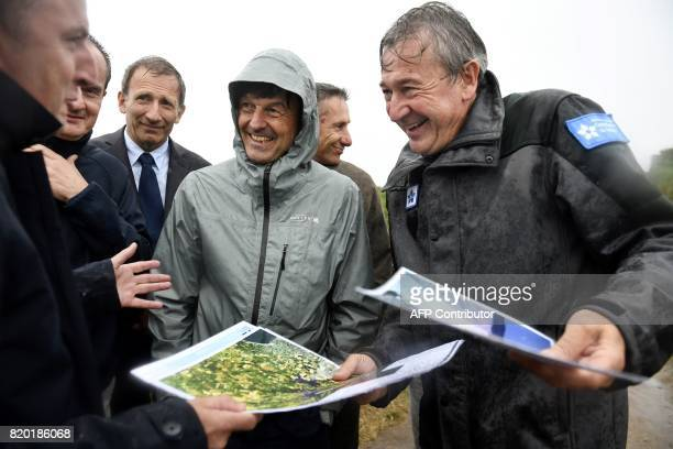 French Minister of Ecological and Inclusive Transition Nicolas Hulot walks by the coast on July 21 2017 in Plouarzel western France during a visit /...