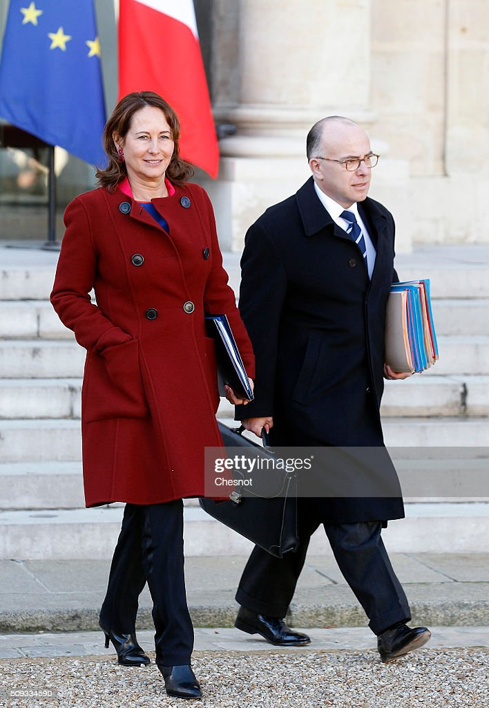 French Minister of Ecology, Sustainable Development and Energy Segolene Royal and Bernard Cazeneuve French Minister of the Interior leave after the weekly cabinet meeting at the Elysee Palace on February 10, 2016 in Paris, France. This is the last cabinet meeting before the next ministerial reshuffle.
