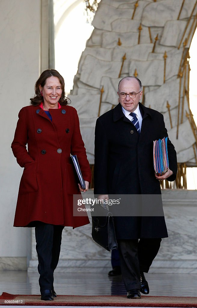 French Minister of Ecology, Sustainable Development and Energy <a gi-track='captionPersonalityLinkClicked' href=/galleries/search?phrase=Segolene+Royal&family=editorial&specificpeople=546504 ng-click='$event.stopPropagation()'>Segolene Royal</a> and <a gi-track='captionPersonalityLinkClicked' href=/galleries/search?phrase=Bernard+Cazeneuve&family=editorial&specificpeople=4205153 ng-click='$event.stopPropagation()'>Bernard Cazeneuve</a> French Minister of the Interior leave after the weekly cabinet meeting at the Elysee Palace on February 10, 2016 in Paris, France. This is the last cabinet meeting before the next ministerial reshuffle.