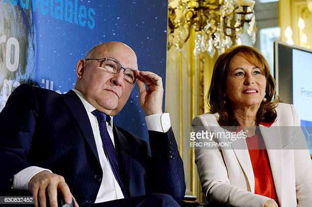 French Minister of Ecology Sustainable Development and Energy Segolene Royal and French Economy and Finance Minister Michel Sapin attend a press...