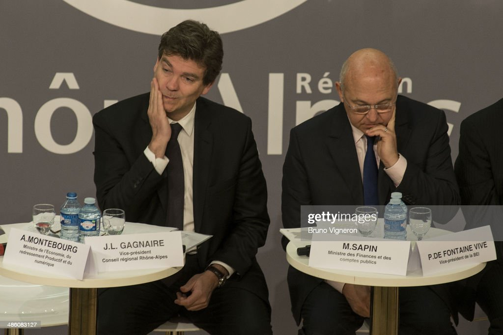 French Minister of Economy and Economic Recovery <a gi-track='captionPersonalityLinkClicked' href=/galleries/search?phrase=Arnaud+Montebourg&family=editorial&specificpeople=588268 ng-click='$event.stopPropagation()'>Arnaud Montebourg</a> (L) and French Minister of Labour <a gi-track='captionPersonalityLinkClicked' href=/galleries/search?phrase=Michel+Sapin&family=editorial&specificpeople=668944 ng-click='$event.stopPropagation()'>Michel Sapin</a> attend the European meeting for enterprises financing on April 22, 2014 in Lyon, France. Sapin and Montebourg are sharing responsibility for the economy based on the German model.