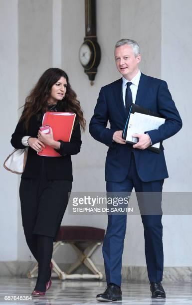 French Minister of Economy Bruno Le Maire and French Minister of State for Gender Equality Marlene Schiappa leave after the weekly cabinet meeting on...