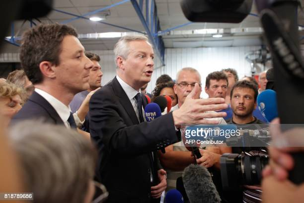 French Minister of Economy Bruno Le Maire flanked by French Junior Economy Minister Benjamin Griveaux speaks to the media during a visit to the site...