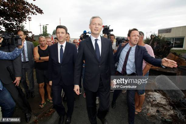 French Minister of Economy Bruno Le Maire flanked by French Junior Economy Minister Benjamin Griveaux visits the site of French auto parts...