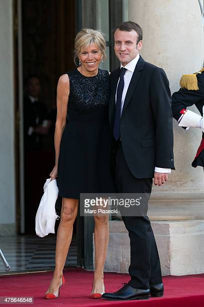French Minister of Economy Emmanuel Macron and wife arrive at the State Dinner offered by French President François Hollande at the Elysee Palace on...