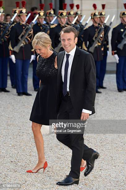 French Minister of Economy Emmanuel Macron and wife arrive for the State Dinner Offered By French President François Hollande at the Elysee Palace on...