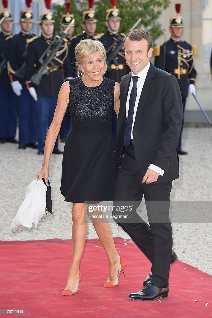 French Minister of Economy <a gi-track='captionPersonalityLinkClicked' href=/galleries/search?phrase=Emmanuel+Macron&family=editorial&specificpeople=9899223 ng-click='$event.stopPropagation()'>Emmanuel Macron</a> (R) and wife Brigitte Trogneux arrive for the State Dinner Offered By French President François Hollande at the Elysee Palace on June 2, 2015 in Paris, France.