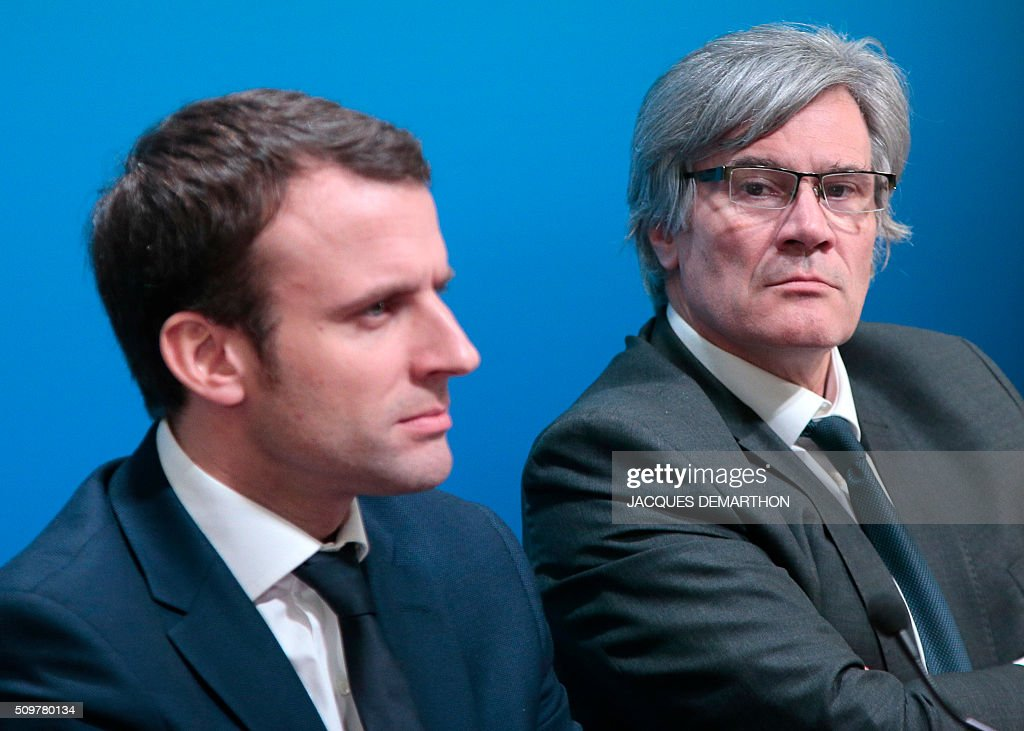 French Minister of Economy, Finance and Industry Emmanuel Macron (L) and French Agriculture Minister Stephane Le Foll give a press conference after a meeting about trade relationships in agricultural and food-processing sectors, at the Agriculture Ministry in Paris on February 12, 2016. / AFP / JACQUES DEMARTHON