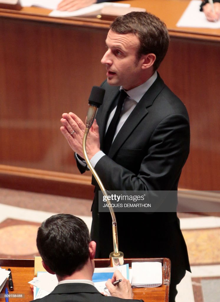 French Minister of Economy, Finance and Industry Emmanuel Macron gestures as he speaks during a session of questions to the government at the French National Assembly in Paris on February 9, 2016. / AFP / JACQUES DEMARTHON