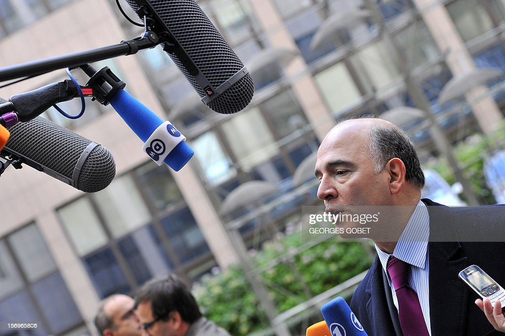 French minister of Economy, Finances and Foreign Trade, Pierre Moscovici answers the media upon his arrival, on November 26, 2012, prior to an Eurozone meeting at the EU Headquarters in Brussels. Eurozone finance ministers and other creditors of Greece as IMF and ECB meet for the third time in two weeks on immediate funding to avert a threat of bankruptcy for Greece and to deal with the country's ever-growing mountain of debt.