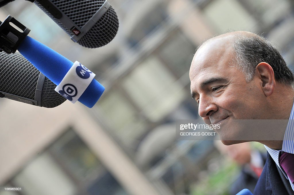 French minister of Economy, Finances and Foreign Trade, Pierre Moscovici answers the media upon his arrival on November 26, 2012 prior to an Eurozone meeting at the EU Headquarters in Brussels. Eurozone finance ministers and other creditors of Greece as IMF and ECB meet for the third time in two weeks on immediate funding to avert a threat of bankruptcy for Greece and to deal with the country's ever-growing mountain of debt.