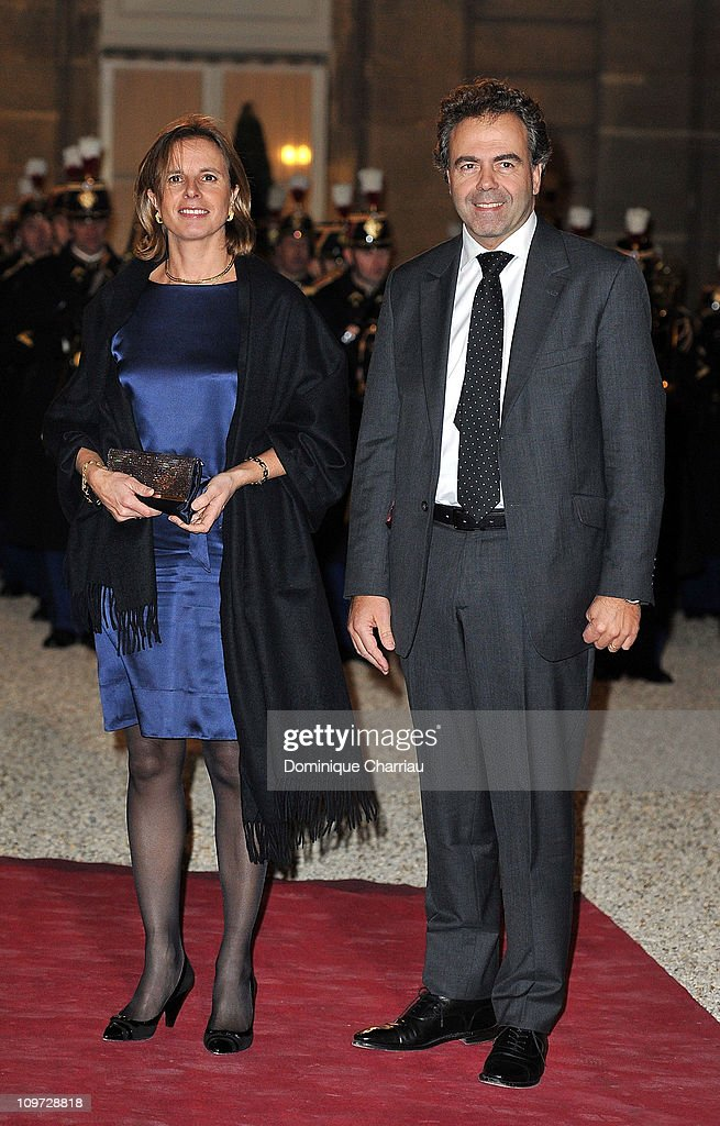 French minister of Education <a gi-track='captionPersonalityLinkClicked' href=/galleries/search?phrase=Luc+Chatel&family=editorial&specificpeople=4292995 ng-click='$event.stopPropagation()'>Luc Chatel</a> and his wife Astrid pose as they arrive to the State Dinner At Elysee Palace Honouring South African President Jacob Zuma at Elysee Palace on March 2, 2011 in Paris, France.
