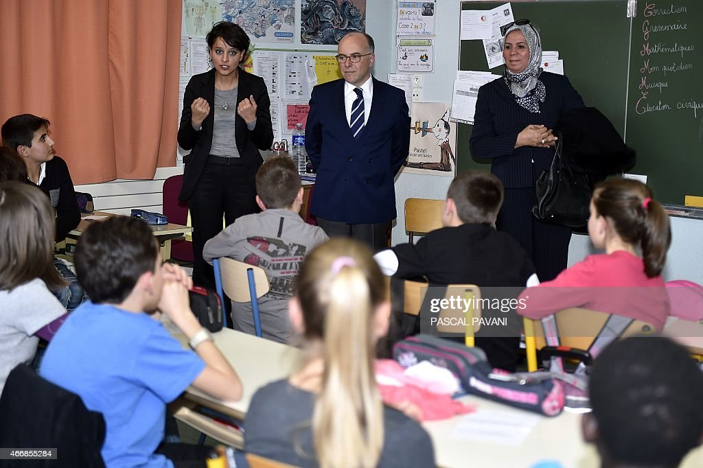 French Minister of Education <a gi-track='captionPersonalityLinkClicked' href=/galleries/search?phrase=Najat+Vallaud-Belkacem&family=editorial&specificpeople=4115928 ng-click='$event.stopPropagation()'>Najat Vallaud-Belkacem</a> (L), French Interior Minister <a gi-track='captionPersonalityLinkClicked' href=/galleries/search?phrase=Bernard+Cazeneuve&family=editorial&specificpeople=4205153 ng-click='$event.stopPropagation()'>Bernard Cazeneuve</a> (C) and Latifa Ibn Ziaten, president of the Imad association and mother of French soldier Imad Ibn Ziaten who was killed by Islamist gunman Mohamed Merah in March 2012, speak to school children at the Jean Dargassies elementary school in Eaunes on March 19, 2015 in a civic education class during a week of education against racism and antisemitism. AFP PHOTO/ PASCAL PAVANI