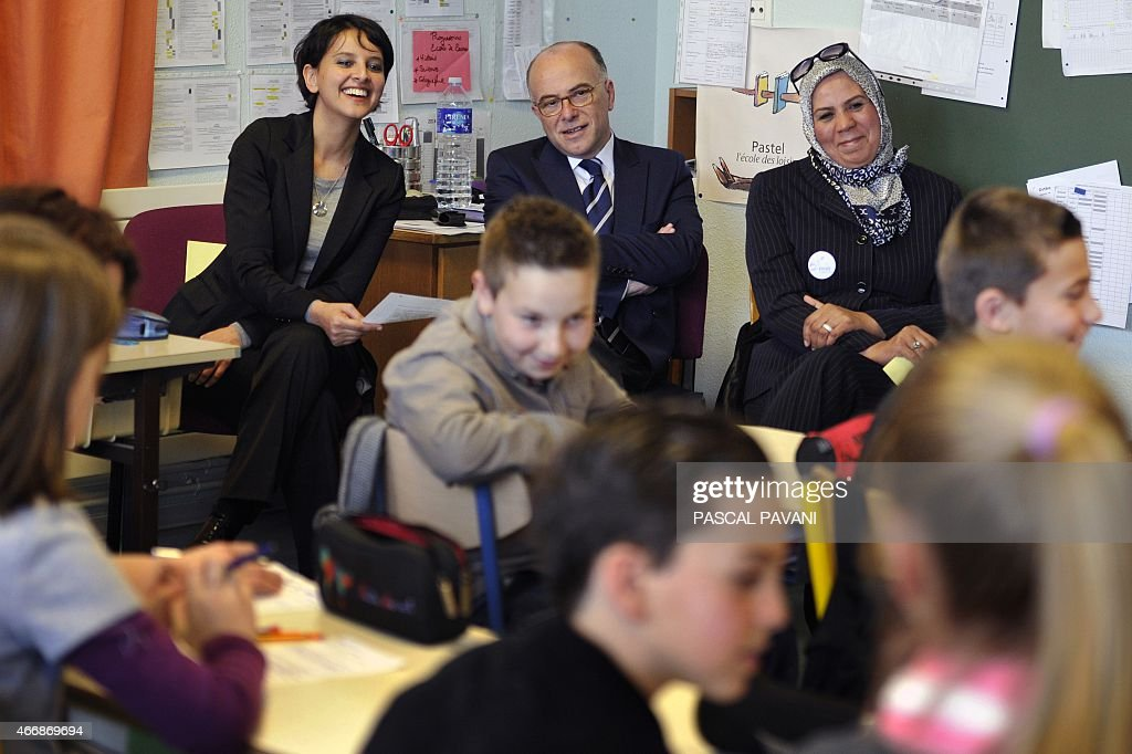 French Minister of Education <a gi-track='captionPersonalityLinkClicked' href=/galleries/search?phrase=Najat+Vallaud-Belkacem&family=editorial&specificpeople=4115928 ng-click='$event.stopPropagation()'>Najat Vallaud-Belkacem</a> (L), French Interior Minister <a gi-track='captionPersonalityLinkClicked' href=/galleries/search?phrase=Bernard+Cazeneuve&family=editorial&specificpeople=4205153 ng-click='$event.stopPropagation()'>Bernard Cazeneuve</a> (C) and Latifa Ibn Ziaten (R), president of the Imad association and mother of French soldier Imad Ibn Ziaten who was killed by Islamist gunman Mohamed Merah in March 2012, smile as they speak to school children at the Jean Dargassies elementary school in Eaunes on March 19, 2015 in a civic education class during a week of education against racism and antisemitism.