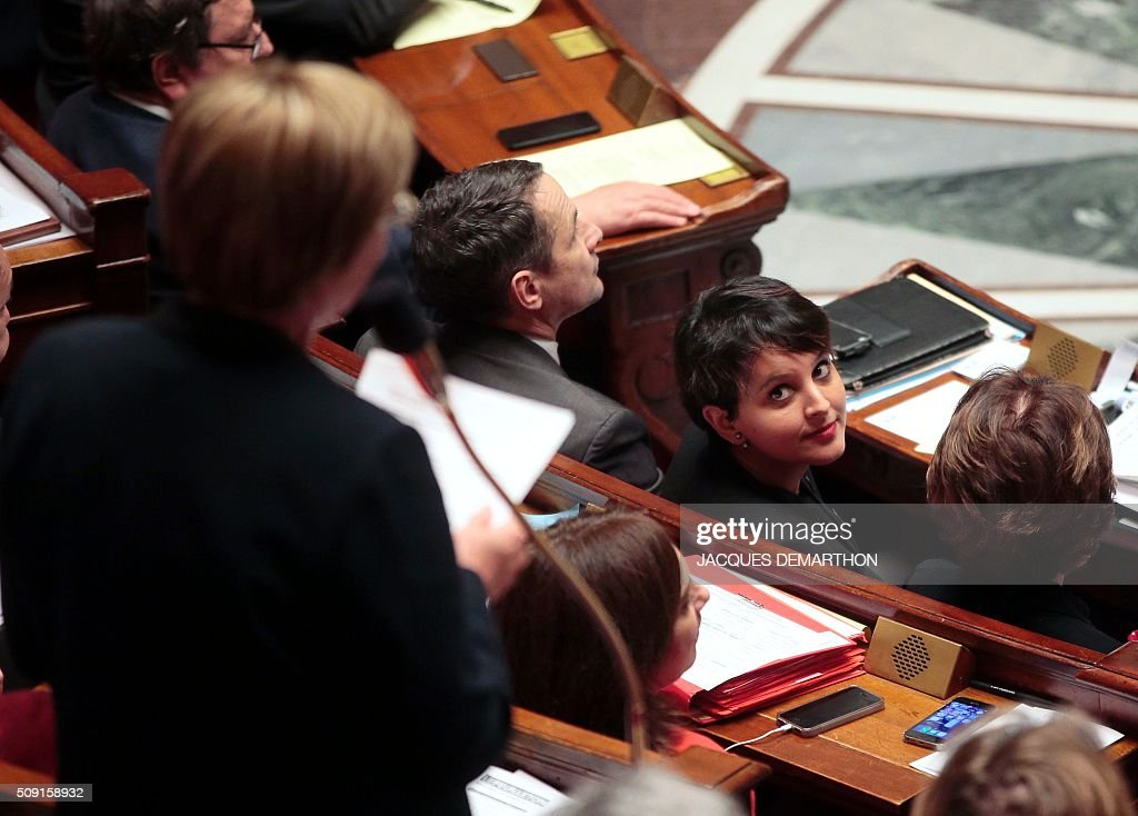 French Minister of Education Najat Vallaud-Belkacem looks on as MP Colette Langlade (L) asks a question during a session of questions to the government at the French National Assembly in Paris on February 9, 2016. / AFP / JACQUES DEMARTHON