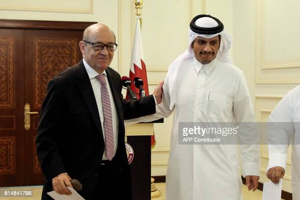 French Minister of Europe and Foreign Affairs JeanYves Le Drian embraces his Qatari counterpart Mohammed bin Abdulrahman alThani as they walk out of...