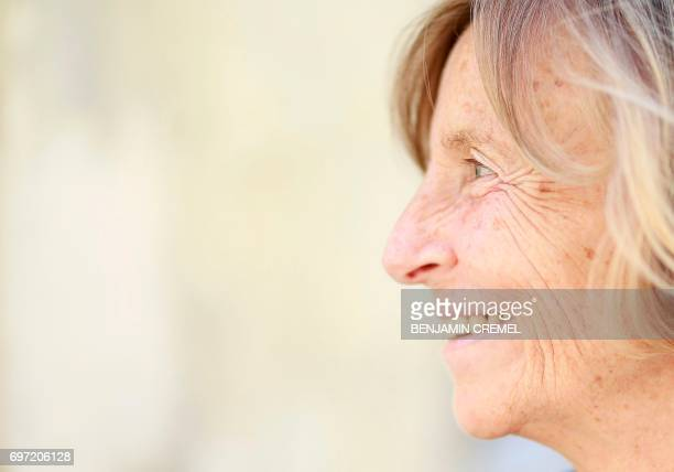 French Minister of European Affairs Marielle de Sarnez smiles as she arrives to cast her vote at a polling station in Paris on June 18 during the...
