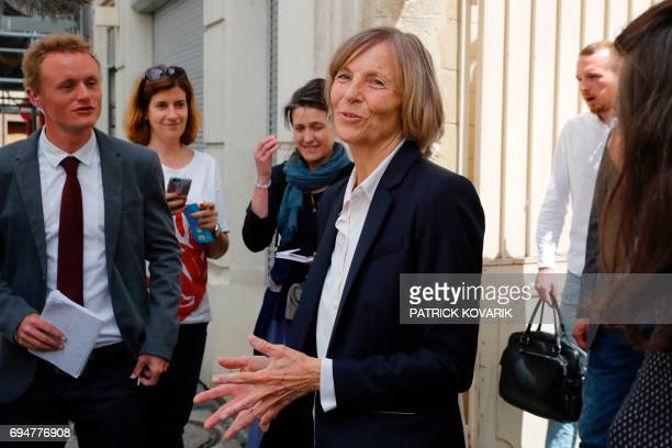 French Minister of European Affairs Marielle de Sarnez speaks to journalists as she leaves a polling station after casting her vote in Paris during...