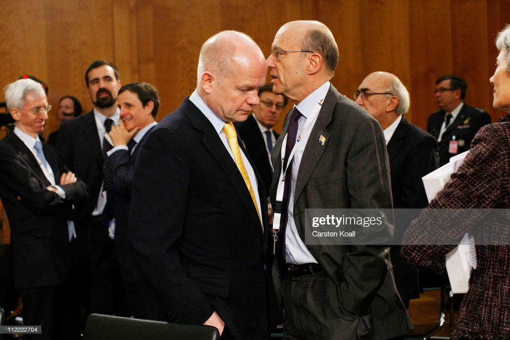French Minister of foreign affairs <a gi-track='captionPersonalityLinkClicked' href=/galleries/search?phrase=Alain+Juppe&family=editorial&specificpeople=235359 ng-click='$event.stopPropagation()'>Alain Juppe</a> (R) talks with U.K. Foreign Secretary <a gi-track='captionPersonalityLinkClicked' href=/galleries/search?phrase=William+Hague&family=editorial&specificpeople=206295 ng-click='$event.stopPropagation()'>William Hague</a> (L) at an informal meeting of NATO member foreign ministers on April 15, 2011 in Berlin, Germany. The principal focus of the two-day meeting is the alliance's military involvement in the war in Libya, though it also includes special roundtables on the alliance's relationship to Russia, Ukraine and Georgia.