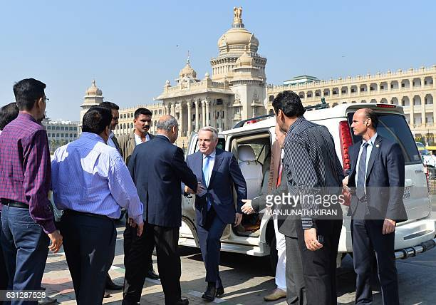 French Minister of Foreign Affairs and International Development JeanMarc Ayrault shakes hands with Bangalore Metro chairman Pradeep Singh Kharola as...