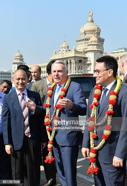French Minister of Foreign Affairs and International Development JeanMarc Ayrault talks next to Bangalore Metro chairman Pradeep Singh Kharola as he...
