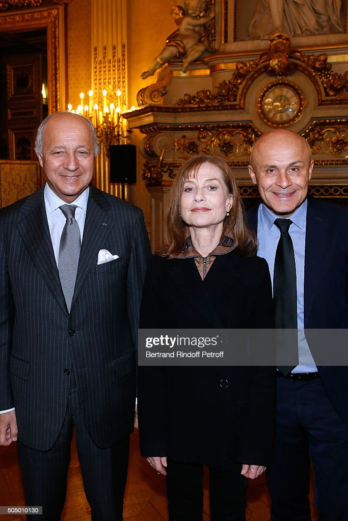 French Minister of Foreign Affairs, <a gi-track='captionPersonalityLinkClicked' href=/galleries/search?phrase=Laurent+Fabius&family=editorial&specificpeople=540660 ng-click='$event.stopPropagation()'>Laurent Fabius</a>, Actress and Sponsor of 'Le Grand Tour', <a gi-track='captionPersonalityLinkClicked' href=/galleries/search?phrase=Isabelle+Huppert&family=editorial&specificpeople=662796 ng-click='$event.stopPropagation()'>Isabelle Huppert</a> and Ambassador for the cultural attractiveness of France, Olivier Poivre d'Arvor launch 'Le Grand Tour' at Quai d'Orsay on January 14, 2016 in Paris, France.