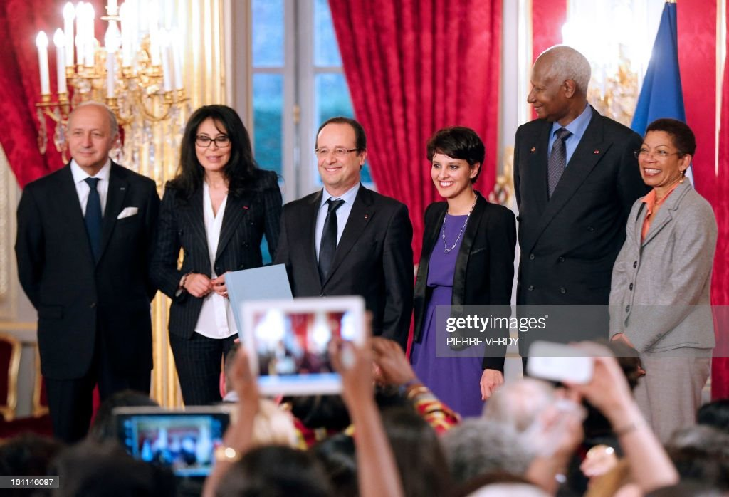 French Minister of Foreign Affairs, Laurent Fabius, France's Junior Minister for French Living Abroad and Francophony, Yamina Benguigui, France's president Francois Hollande, French Minister for Women's Rights and Government Spokesperson Najat Vallaud-Belkacem, General Secretary of the International Organization of Francophonie (IOF) and former Senegalese President Abdou Diouf, and French Junior Minister for Educational Success George Pau-Langevin pose for pictures following a meeting with Francophone women from the Global Forum on March 20, 2013, at the Elysee presidential Palace in Paris. The Global Forum for Francophone women gathered 400 women from 77 countries.