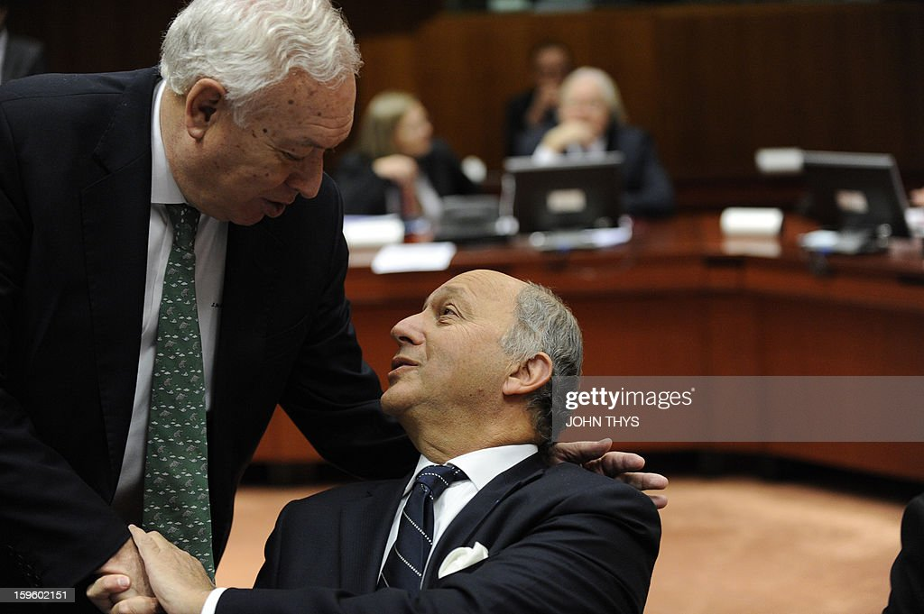 French Minister of Foreign Affairs Laurent Fabius speaks with Spanish Foreign minister Jose Manuel Garcia Margallo (L) before a EU Foreign Affairs ministers council on Mali conflit at the EU Headquarters in Brussels on January 17, 2013.