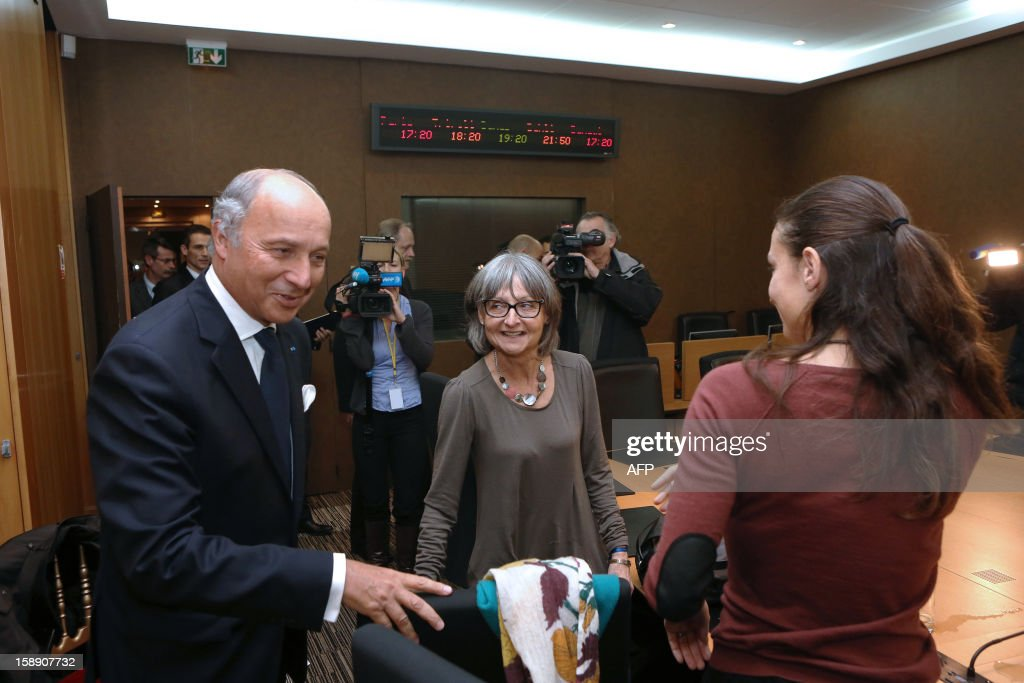 French Minister of Foreign Affairs, Laurent Fabius (L) welcomes Françoise Larribe (C), the wife of French hostage Daniel Larribe, and her daughter Marion (R) prior to a roundtable meeting, on January 3, 2013, at the French Foreign Affairs Ministry in Paris. Daniel Larribe is one of the four French hostages kidnapped on September 16, 2010 in Arlit in northern Niger by a North African offshoot of Al-Qaeda in the Islamic Maghreb (AQIM). AFP PHOTO / POOL / FREDERIC DE LA MURE
