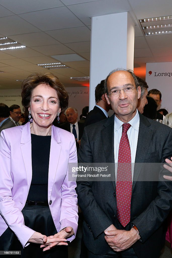 French Minister of Health Marisol Touraine and <a gi-track='captionPersonalityLinkClicked' href=/galleries/search?phrase=Eric+Woerth&family=editorial&specificpeople=4140491 ng-click='$event.stopPropagation()'>Eric Woerth</a> attend 'L'Opinion' Newspaper Launch Party on May 14, 2013 in Paris, France.