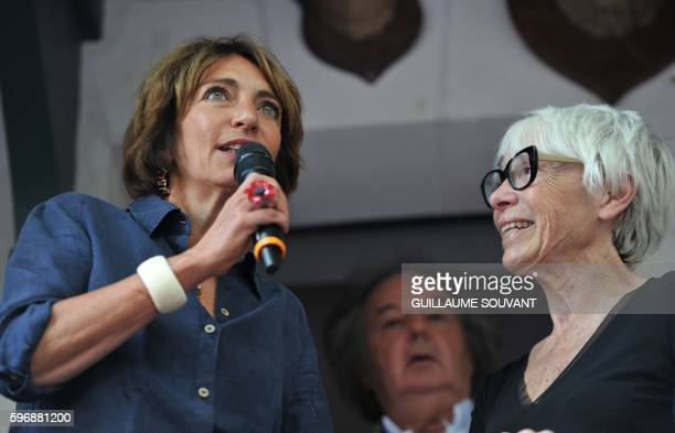 French minister of health Marisole Touraine talks next to French writer Gonzague SaintBris and widow of French former Prime minister Michel Rocard...