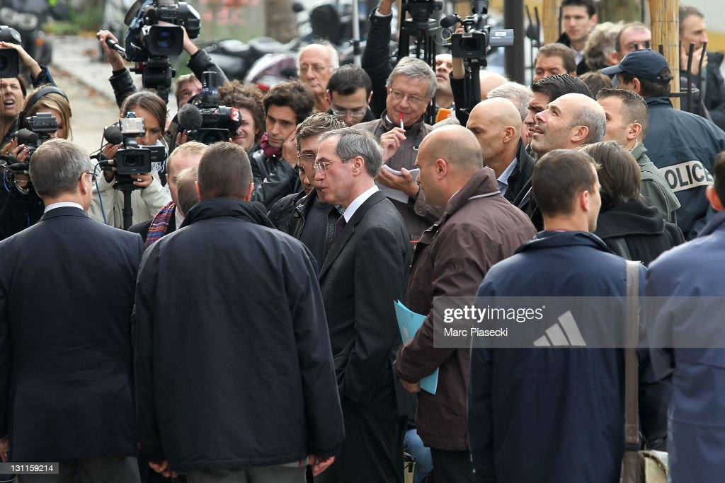 French minister of interior affairs <a gi-track='captionPersonalityLinkClicked' href=/galleries/search?phrase=Claude+Gueant&family=editorial&specificpeople=861764 ng-click='$event.stopPropagation()'>Claude Gueant</a> (C) arrives at the offices French satirical magazine 'Charlie Hebdo' following a petrol bomb attack on November 2, 2011 in Paris, France. The attack, which completely destroyed the offices, comes a day after the French satirical magazine 'Charlie Hebdo' featured a caricature of the Prophet Muhammad on its cover and named him as 'editor-in-chief'.
