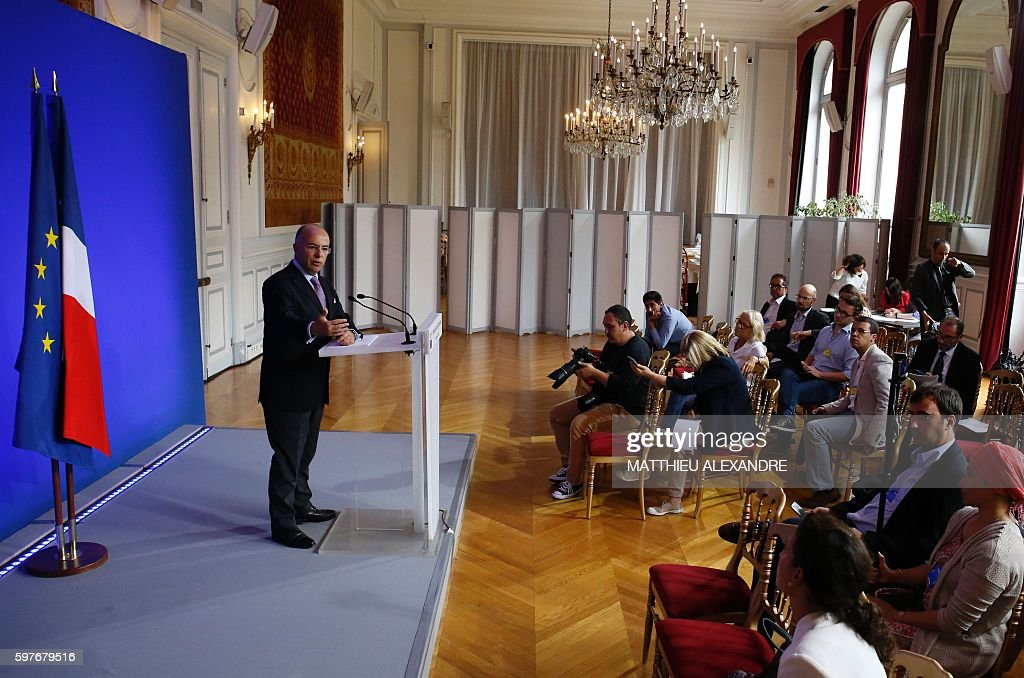 French Minister of Interior Bernard Cazeneuve delivers a speech during a press conference following a meeting with representatives of the Islamic...