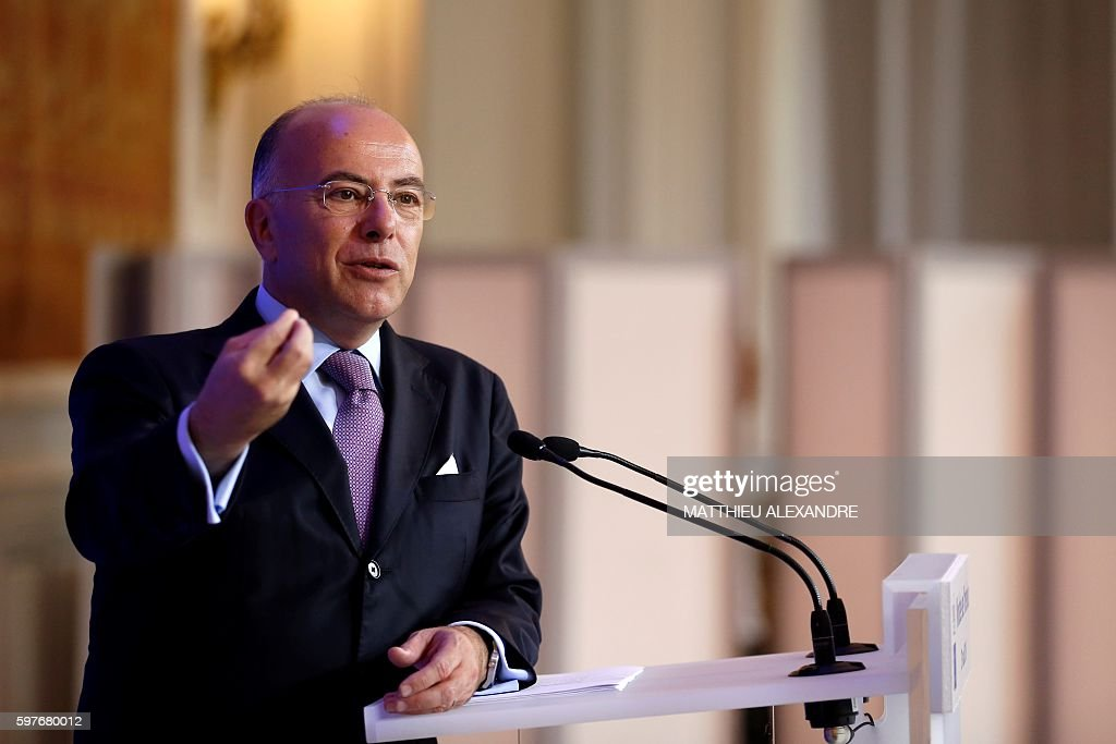 French Minister of Interior Bernard Cazeneuve gestures as he delivers a speech during a press conference following a meeting with representatives of...