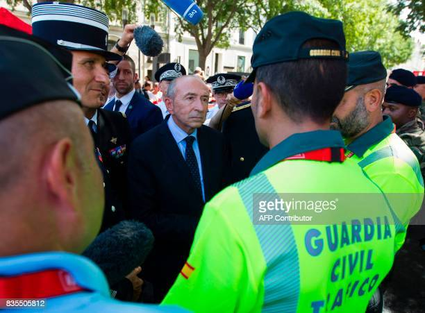 French Minister of Interior Gerard Collomb speaks with members of the Spanish Civil Guard prior to the start of the first stage of the 72nd edition...