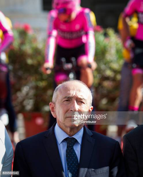 French Minister of Interior Gerard Collomb stands during a minute's silence in solidarity with Barcelona following a vehicle attack on the city prior...