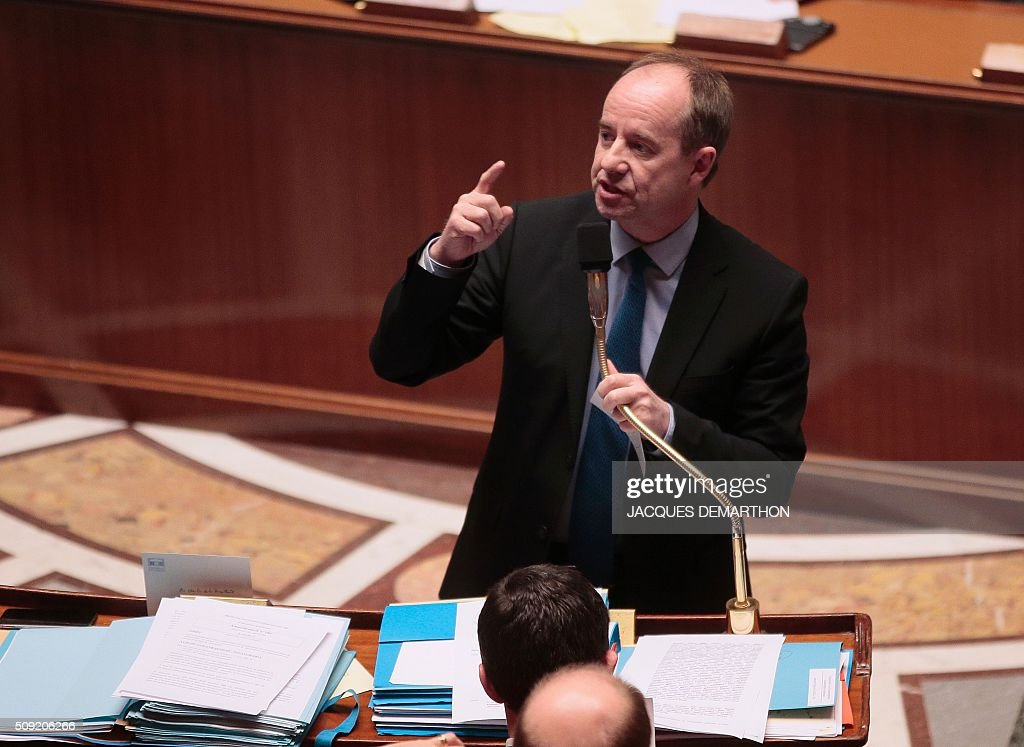 French Minister of Justice Jean-Jacques Urboas gestures as he speaks at the French National Assembly in Paris on February 9, 2016, as French lawmakers examined proposed changes to the constitution. France's lower house of parliament is to vote on plans to enshrine a state of emergency into the constitution, including a controversial measure to strip French nationality from those convicted of terrorism and serious crimes. / AFP / JACQUES DEMARTHON