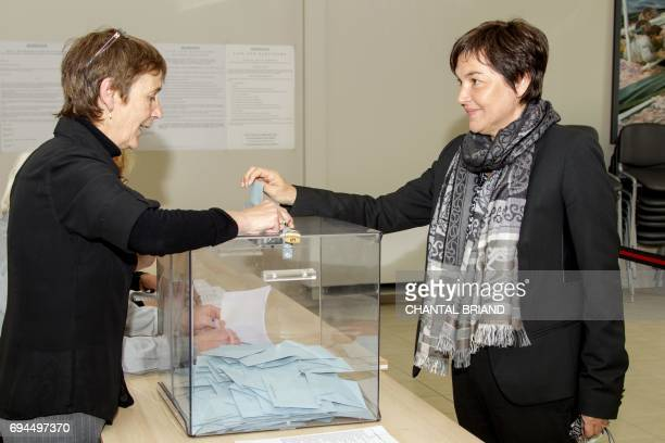 French minister of Overseas Terrotories Annick Girardin casts her ballot in the French legislative elections at a polling station in the French...