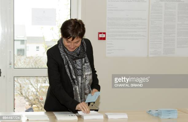 French minister of Overseas Terrotories Annick Girardin prepares to cast her ballot in the French legislative elections at a polling station in the...