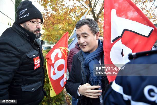 French Minister of Public Action and Accounts Gerald Darmanin speaks with unions members demonstrating during his visit at the tax center in Balma...