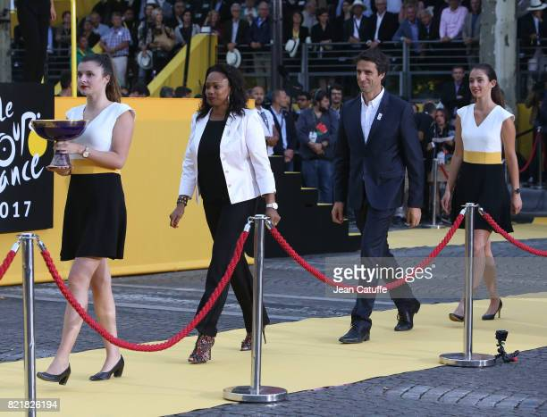 French Minister of Sports Laura Flessel and Tony Estanguet during the trophy ceremony following stage 21 of the Tour de France 2017 a 103km race...
