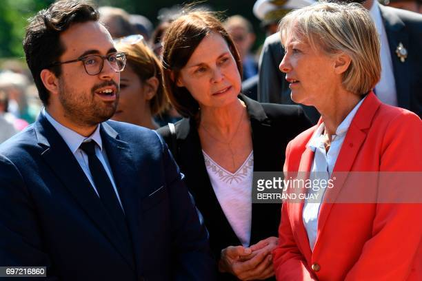 French Minister of State for the Digital Sector Mounir Mahjoubi and French Minister of State for Disabled People Sophie Cluzel talk during a ceremony...