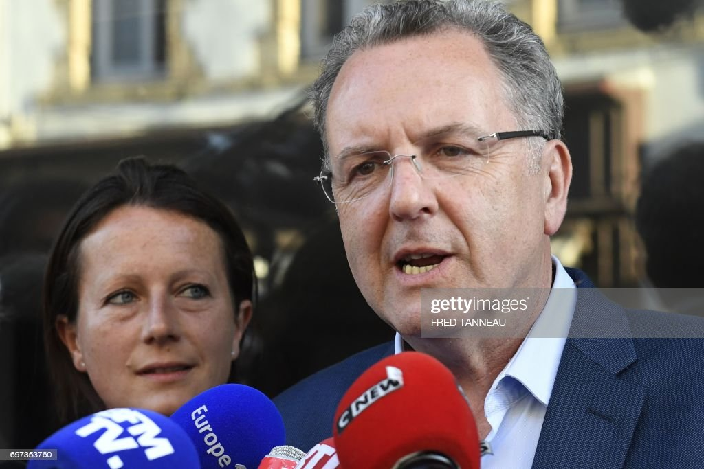 French Minister of Territorial Cohesion Richard Ferrand (1st-R), candidate for France's legislative elections in the 6th constituency of the Finistere department, answers the press in Chateaulin, western France, after the polls closed in the second round of the French parliamentary elections (elections legislatives in French) on June 18, 2017. Ferrand is elected in the 6th constituency of the Finistere. / AFP PHOTO / Fred TANNEAU