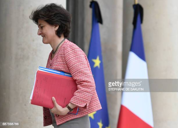 French Minister of the Armed Forces Sylvie Goulard walks past French and European union flags with black ribbons following the May 22 terror attack...