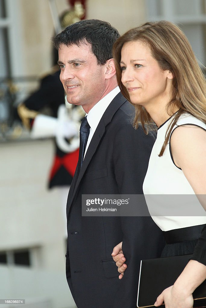 French Minister of the Interior <a gi-track='captionPersonalityLinkClicked' href=/galleries/search?phrase=Manuel+Valls&family=editorial&specificpeople=2178864 ng-click='$event.stopPropagation()'>Manuel Valls</a> and his wife Anne Gravoin arrive to attend a state dinner at Palace Elysee on May 7, 2013 in Paris, France.