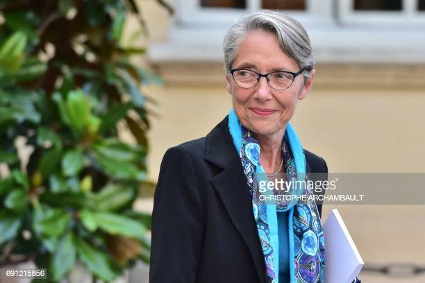 French Minister of Transport Elisabeth Borne walks at the Hotel de Matignon in Paris on June 1 during a launch meeting with three ombudsmen appointed...