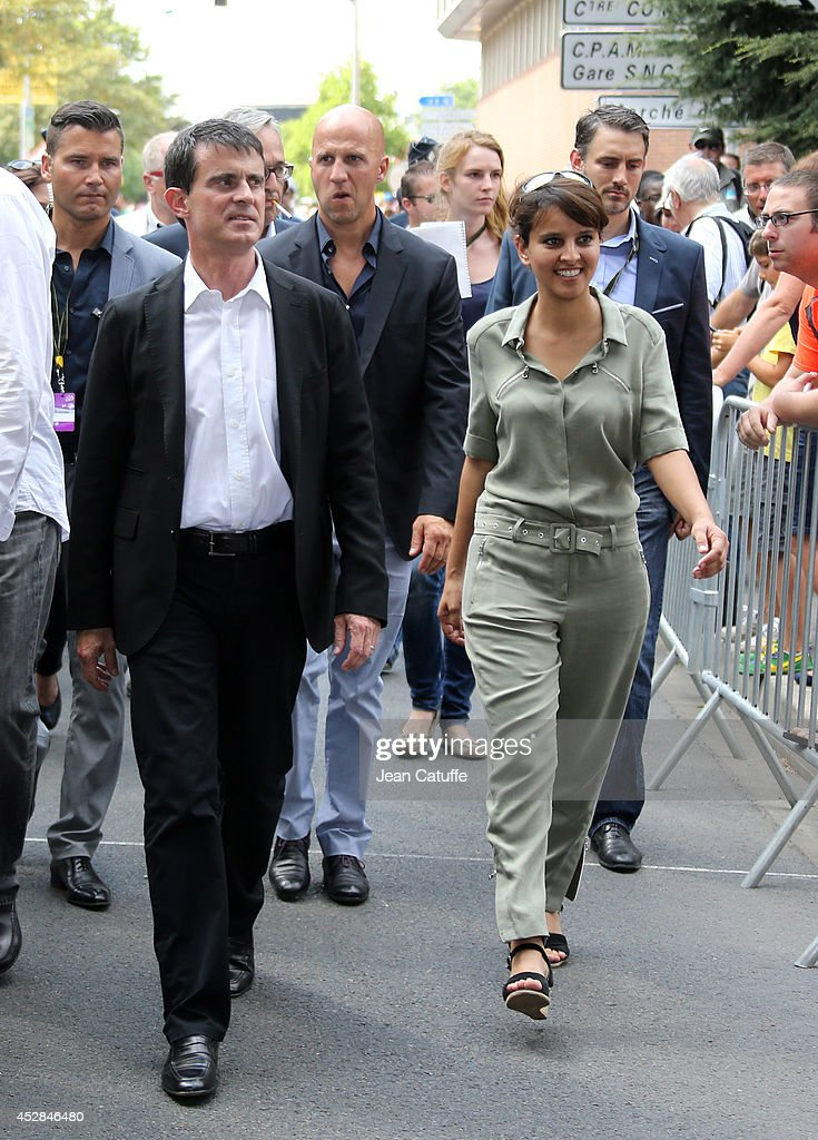 French Minister of Women's Rights and Sports <a gi-track='captionPersonalityLinkClicked' href=/galleries/search?phrase=Najat+Vallaud-Belkacem&family=editorial&specificpeople=4115928 ng-click='$event.stopPropagation()'>Najat Vallaud-Belkacem</a> and French Prime Minister <a gi-track='captionPersonalityLinkClicked' href=/galleries/search?phrase=Manuel+Valls&family=editorial&specificpeople=2178864 ng-click='$event.stopPropagation()'>Manuel Valls</a> walk back to their cars after giving the start of the twenty one and last stage of the 2014 Tour de France, a 134 km individual time trial stage between Evry and the Champs-Elysees in Paris on July 27, 2014 in Evry, France.
