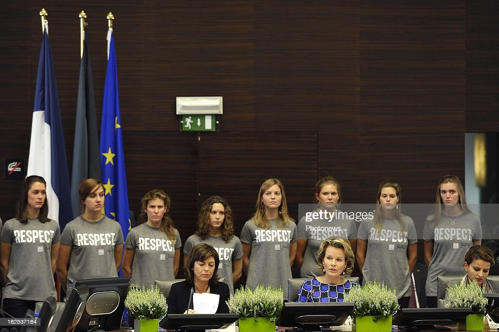 French Minister of Women's rights <a gi-track='captionPersonalityLinkClicked' href=/galleries/search?phrase=Najat+Vallaud-Belkacem&family=editorial&specificpeople=4115928 ng-click='$event.stopPropagation()'>Najat Vallaud-Belkacem</a> and <a gi-track='captionPersonalityLinkClicked' href=/galleries/search?phrase=Joelle+Milquet&family=editorial&specificpeople=4324706 ng-click='$event.stopPropagation()'>Joelle Milquet</a> Belgium Minister of Interior Affairs (L) attend an international conference for the 65th anniversary of the UN Convention on September 30, 2013 in Brussels, Belgium.