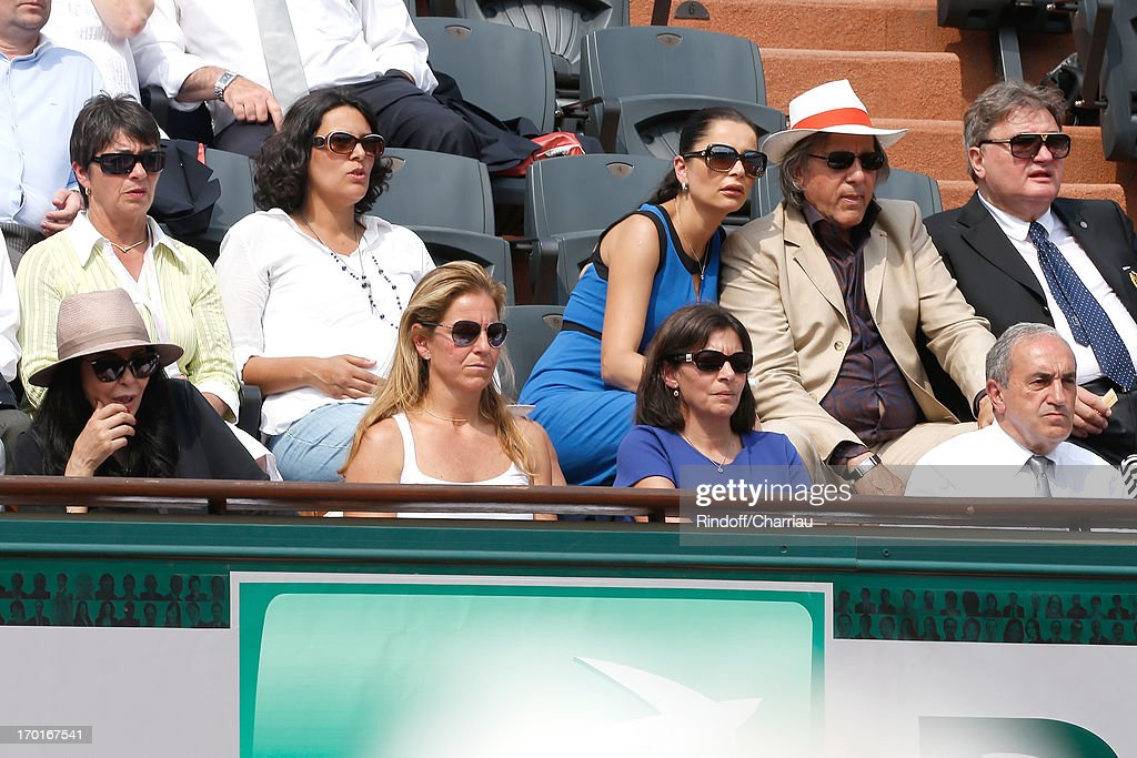 French Minister <a gi-track='captionPersonalityLinkClicked' href=/galleries/search?phrase=Yamina+Benguigui&family=editorial&specificpeople=615509 ng-click='$event.stopPropagation()'>Yamina Benguigui</a>, former tennis player Arantxa Sanchez Vicario, Anne Hidalgo, President of FFT Jean Gachassin and his wife Minou, (2nd Row R) Ilie Nastase and wife sighting at Roland Garros Tennis French Open 2013 - Day 14 on June 8, 2013 in Paris, France.